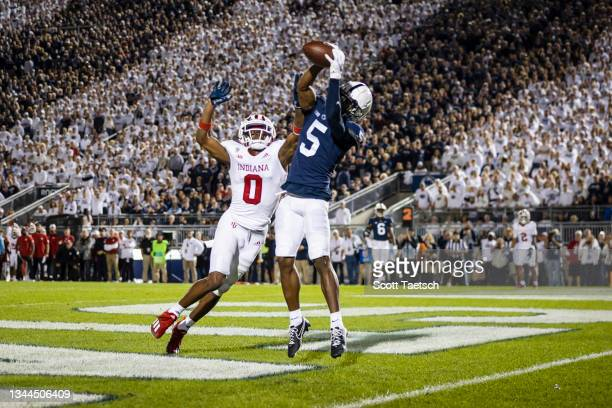 Jahan Dotson of the Penn State Nittany Lions catches a pass for a touchdown in front of Raheem Layne II of the Indiana Hoosiers during the first half...