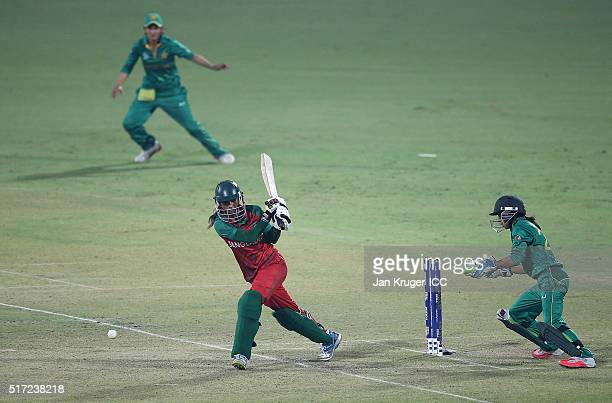 Jahanara Alam Captain of Bangladesh hits out with Sidra Nawaz of Pakistan looking on during the Women's ICC World Twenty20 India 2016 match between...