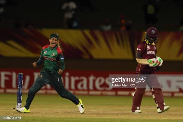 Jahanara Alam of Bangladesh celebrates getting the wicket of Deandra Dottin of Windies at Providence Stadium on November 9, 2018 in Providence,...
