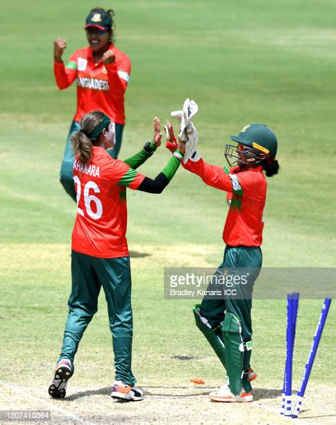 Jahanara Alam of Bangladesh celebrates victory with her team mates after taking the last wicket of the match during the ICC Women's T20 Cricket World...