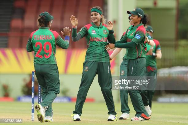 Jahanara Alam of Bangladesh celebrates with teammates Rumana Ahmed and Sanjida Islam during the ICC Women's World T20 warm up match between...