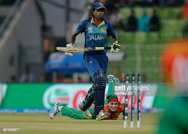 Jahanara Alam of Bangladesh gets Yasoda Mendis of Sri Lanka run out during the ICC Women's World Twenty20 match between Bangladesh Women and Sri Lank...