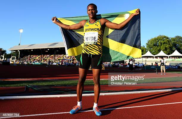 Jaheel Hyde of Jamaica poses with the flag on the track after winning the men's 400m hurdles on day four of the IAAF World Junior Championships at...