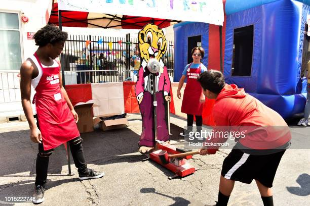 Jaheem Toombs and Bryson Robinson volunteer at the Los Angeles Mission's End of Summer Art and Education Fair at Los Angeles Mission on August 11...
