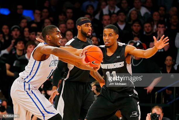 Jahenns Manigat of the Creighton Bluejays passes as Bryce Cotton of the Providence Friars defends in the first half during the Championship game of...