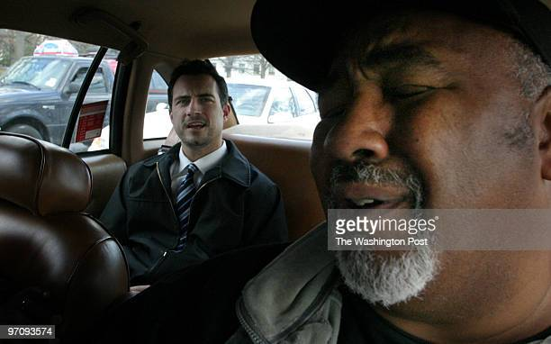 ME_TAXI 2/17/2005 jahi chikwendiu Adrian Brocks a DC native and taxi driver gimaces while in a conversation with Stacy Lloyd of Arlington about...