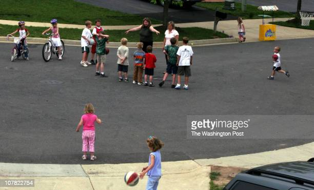 ME_FAMILIES jahi chikwendiu Donna Meyers and Lori Campbell help kids break up into kickball teams where 27 kids live on this small culdesac in South...