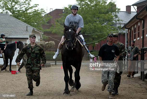 P_SOLDIERS jahi chikwendiu Spec Maxwell Ramsey who lost his leg to an IED on March 1 of this year in Ramadi Iraq rides a horse as patients from the...