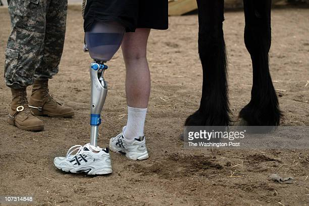 P_SOLDIERS jahi chikwendiu Spec Maxwell Ramsey who lost his leg to an IED on March 1 of this year in Ramadi Iraq finishes a riding session as...