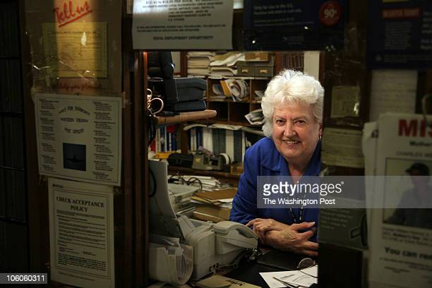 LD_SCHEEL1 9262006 jahi chikwendiu/TWP Laura D Pearson working in the post office at the Philomont General Store in Philomont VA is a US postmaster...