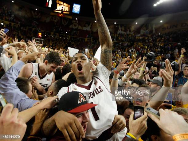 Jahii Carson of the Arizona State Sun Devils is lifted up by students in celebration of a 6966 victory over the Arizona Wildcats during a college...