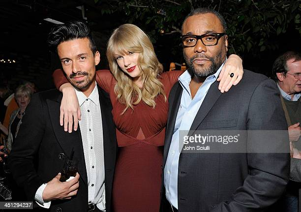 Jahil Fisher Taylor Swift and Lee Daniels attend the Weinstein Company's holiday party at RivaBella on November 21 2013 in West Hollywood California