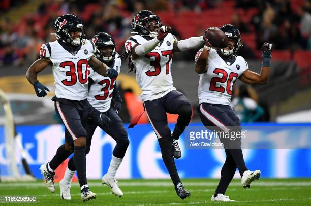 Jahleel Addae of Houston Texans celebrates a interception with his teammates during the NFL game between Houston Texans and Jacksonville Jaguars at...