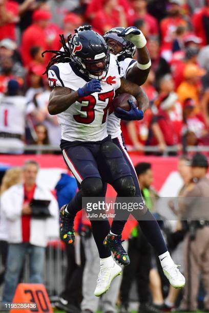 Jahleel Addae of the Houston Texans celebrates with Tashaun Gipson after intercepting Jameis Winston of the Tampa Bay Buccaneers during the fourth...