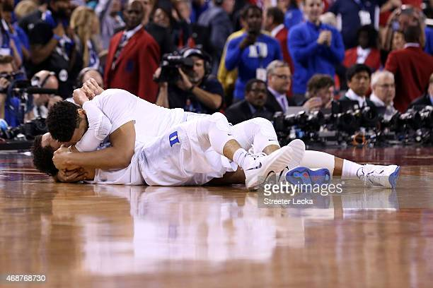 Jahlil Okafor and Tyus Jones of the Duke Blue Devils celebrate after defeating the Wisconsin Badgers during the NCAA Men's Final Four National...