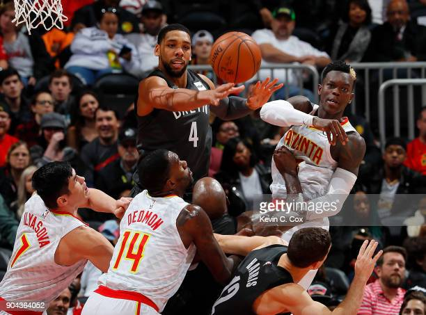 Jahlil Okafor of the Brooklyn Nets and Dennis Schroder of the Atlanta Hawks knock away a rebound over Milton Doyle Ersan Ilyasova and Dewayne Dedmon...