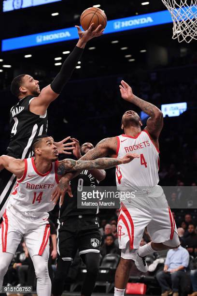 Jahlil Okafor of the Brooklyn Nets gets a rebound over Gerald Green and PJ Tucker of the Houston Rockets during the game at Barclays Center on...