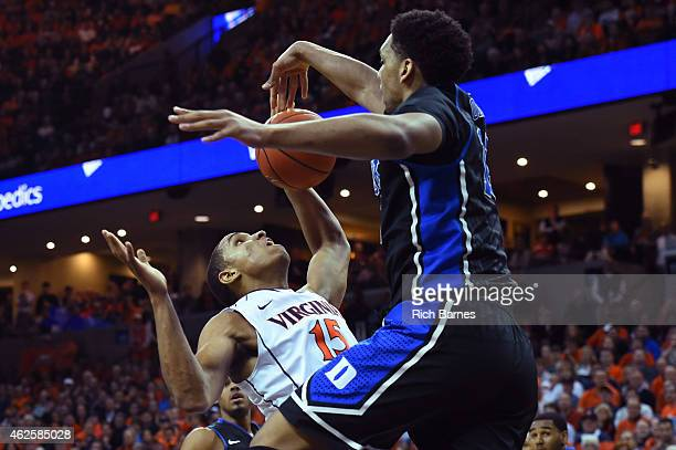 Jahlil Okafor of the Duke Blue Devils blocks the shot of Malcolm Brogdon of the Virginia Cavaliers during the first half at John Paul Jones Arena on...