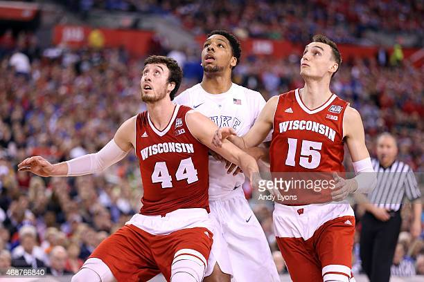 Jahlil Okafor of the Duke Blue Devils competes for position with Frank Kaminsky and Sam Dekker of the Wisconsin Badgers in the second half during the...