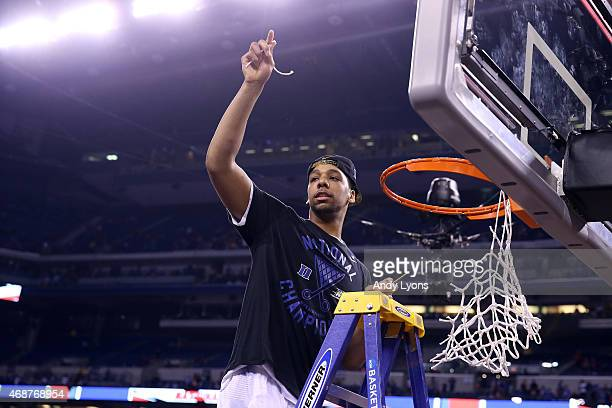 Jahlil Okafor of the Duke Blue Devils cuts down the net after defeating the Wisconsin Badgers during the NCAA Men's Final Four National Championship...