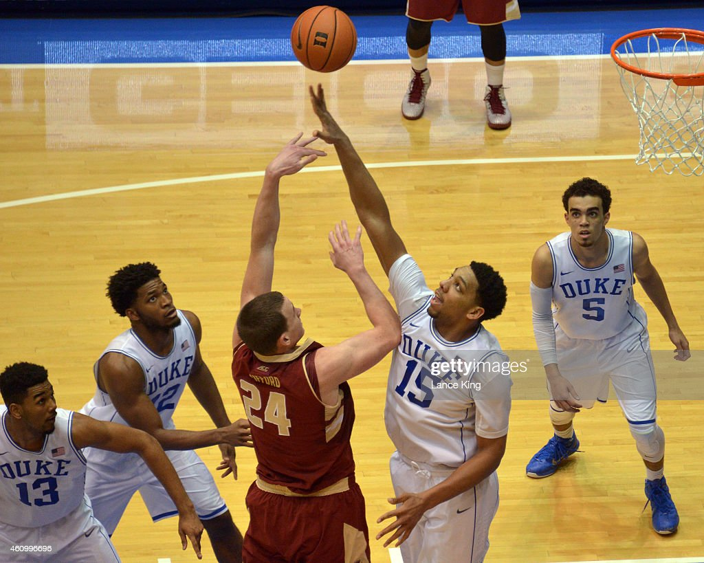 Jahlil Okafor #15 of the Duke Blue Devils defends a shot by Dennis Clifford #24 of the Boston College Eagles during their game at Cameron Indoor Stadium on January 3, 2015 in Durham, North Carolina. Duke defeated Boston College 85-62.