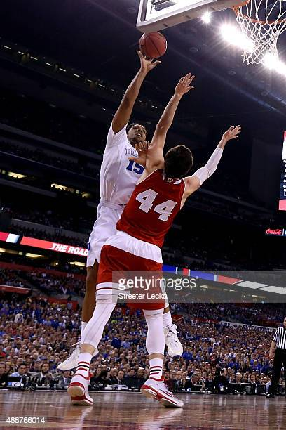 Jahlil Okafor of the Duke Blue Devils drives to the basket against Frank Kaminsky of the Wisconsin Badgers in the first half during the NCAA Men's...