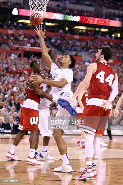 Jahlil Okafor of the Duke Blue Devils drives to the basket against Nigel Hayes and Frank Kaminsky of the Wisconsin Badgers in the second half during...