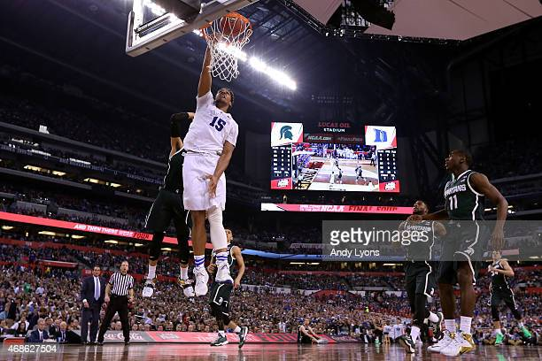 Jahlil Okafor of the Duke Blue Devils goes up for a dunk in the second half against the Michigan State Spartans during the NCAA Men's Final Four...