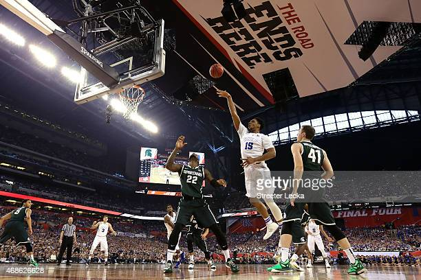 Jahlil Okafor of the Duke Blue Devils shoots against Branden Dawson and Colby Wollenman of the Michigan State Spartans in the first half during the...