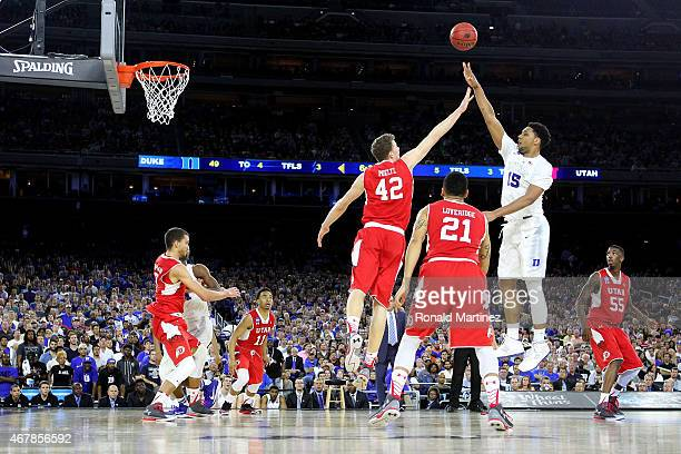 Jahlil Okafor of the Duke Blue Devils takes a shot over Jakob Poeltl of the Utah Utes during a South Regional Semifinal game of the 2015 NCAA Men's...