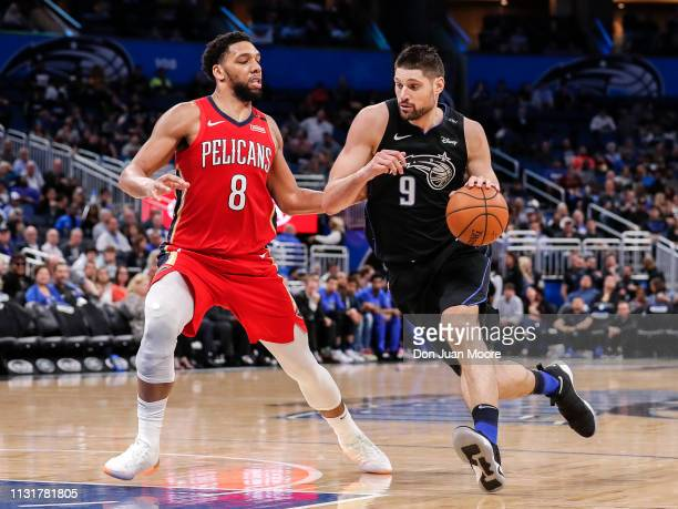Jahlil Okafor of the New Orlean Pelicans defends Nikola Vucevic of the Orlando Magic during the game at the Amway Center on March 20 2019 in Orlando...