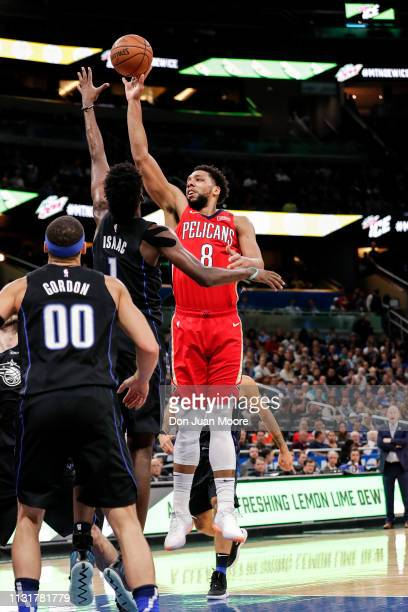 Jahlil Okafor of the New Orlean Pelicans shoots over Jonathan Isaac of the Orlando Magic during the game at the Amway Center on March 20 2019 in...