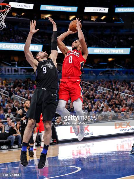 Jahlil Okafor of the New Orlean Pelicans shoots over Nikola Vucevic of the Orlando Magic during the game at the Amway Center on March 20 2019 in...
