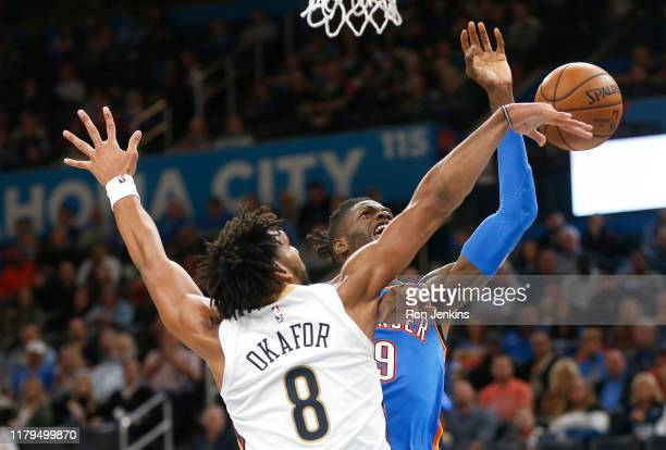 Jahlil Okafor of the New Orleans Pelicans blocks a shot by Nerlens Noel of the Oklahoma City Thunder during the first half at Chesapeake Energy Arena...