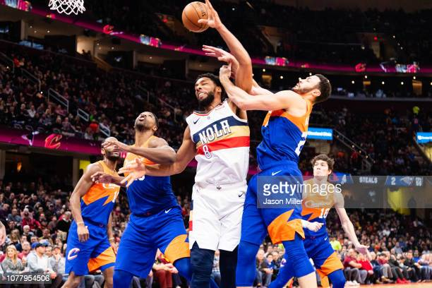 Jahlil Okafor of the New Orleans Pelicans fights Tristan Thompson and Larry Nance Jr #22 of the Cleveland Cavaliers for a rebound during the first...