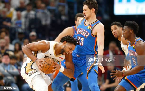 Jahlil Okafor of the New Orleans Pelicans protects the ball from Mike Muscala of the Oklahoma City Thunder during the first half at Chesapeake Energy...