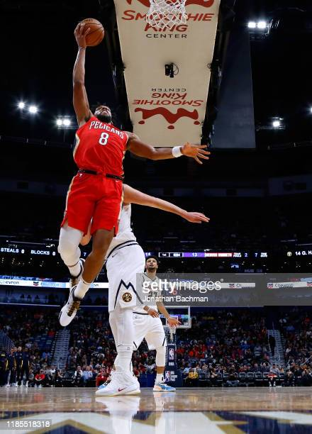 Jahlil Okafor of the New Orleans Pelicans shoots against Nikola Jokic of the Denver Nuggets during a game at the Smoothie King Center on October 31...