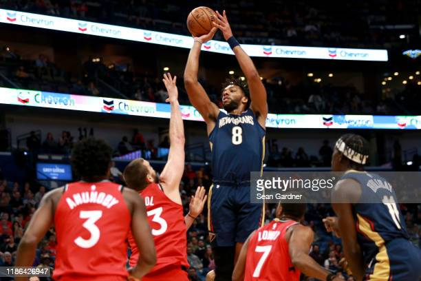 Jahlil Okafor of the New Orleans Pelicans takes a shoots over Marc Gasol of the Toronto Raptors during a NBA game at the Smoothie King Center on...