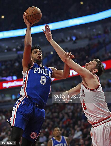 Jahlil Okafor of the Philadelphia 76ers goes up for a shot against Pau Gasol of the Chicago Bulls at the United Center on December 14 2015 in Chicago...