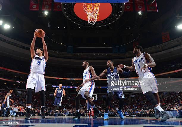 Jahlil Okafor of the Philadelphia 76ers grabs the rebound against the Memphis Grizzlies at Wells Fargo Center on December 22 2015 in Philadelphia...