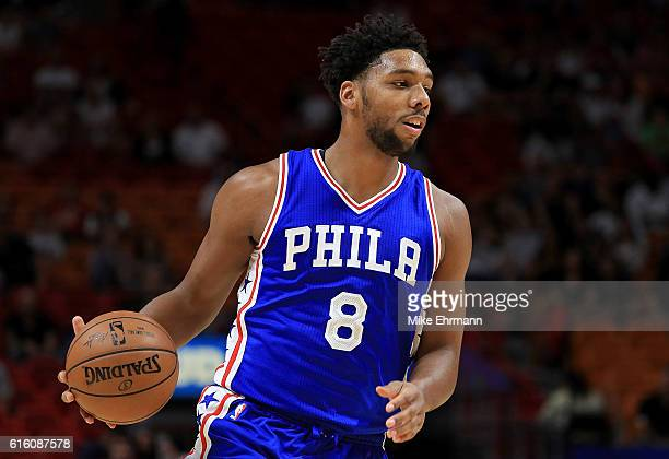 Jahlil Okafor of the Philadelphia 76ers looks to pass during a preseason game against the Miami Heat at American Airlines Arena on October 21 2016 in...