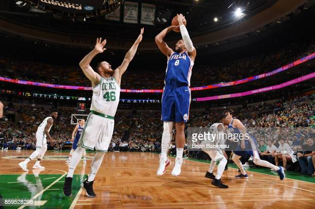 Jahlil Okafor of the Philadelphia 76ers shoots the ball against Aron Baynes of the Boston Celtics during the preseason game on October 9 2017 at the...