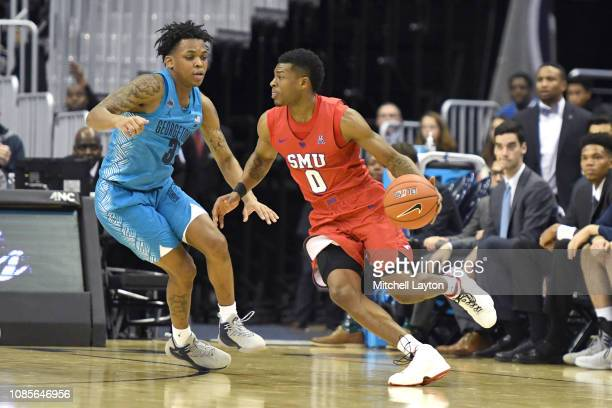 Jahmal McMurray of the Southern Methodist Mustangs dribbles around James Akinjo of the Georgetown Hoyasduring a college basketball game the Capital...