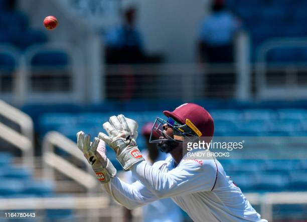 Jahmar Hamilton of West Indies attempts to catch Virat Kohli of India during day 1 of the 2nd Test between West Indies and India at Sabina Park,...