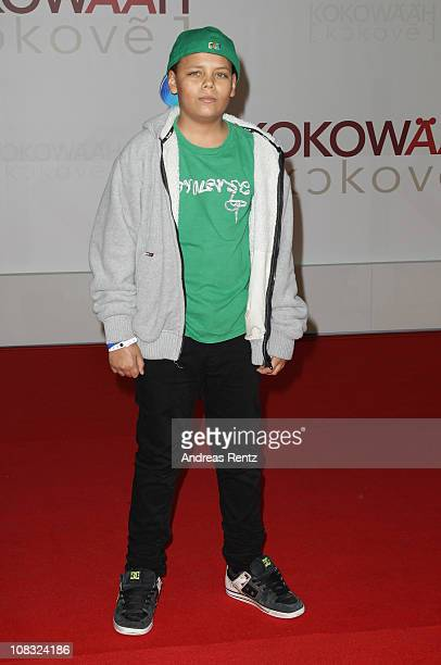 Jahmar Walker son of actress AnneSophie Briest arrives for the ''Kokowaeaeh' Germany Premiere at CineStar on January 25 2011 in Berlin Germany
