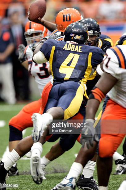 Jahmile Addae of the West Virginia University Mountaineers attempts a sack against Quarterback Perry Patterson of the Syracuse University Orange on...