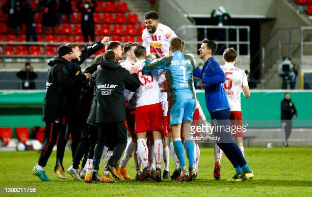 Jahn Regensburg players celebrate victory after winning the penalty shoot out in the DFB Cup Round of Sixteen match between Jahn Regensburg and 1. FC...