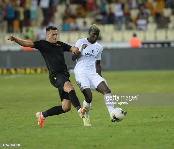 Jahociv of Yeni Malatyaspor vies with Bagnack during the UEFA Europa League second qualifying match between Yeni Malatyaspor and Olimpija Ljubljana...