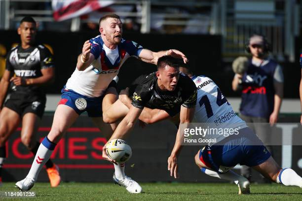 Jahrome Hughes of the Kiwis passes in the air during the International Rugby League Test Match between the New Zealand Kiwis and the Great Britain...