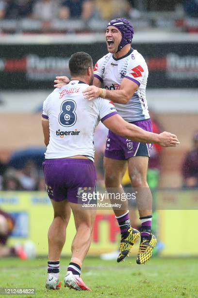 Jahrome Hughes of the Storm and Jesse Bromwich of the Storm celebrate a try during the round 1 NRL match between the Manly Sea Eagles and the...